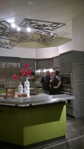 Dale Kendall and me posing in front of out kitchen at AllState.